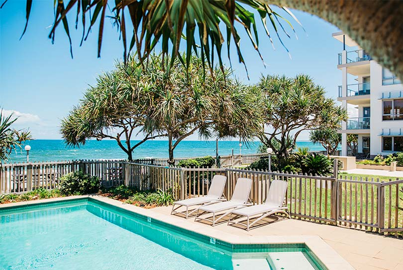 View of pool and Kings Beach from Unit 1 at Pandanus Court